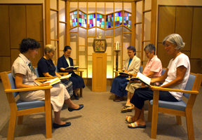 Sisters at prayer in the chapel sanctuary